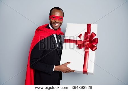 Portrait Of Nice Attractive Cheerful Guy Wearing Suit Hero Look Outfit Holding In Hands Giftbox Even