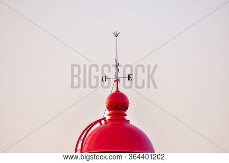Red Dome Of The Ponta Da Piedade Lighthouse, With A Wind Vane On Top. Algarve, Portugal