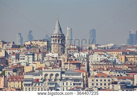 Galata Tower, Cityscape And Istanbul View From Suleymaniye Mosques Garden In Istanbul With Historica