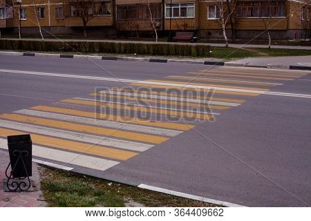 Pedestrian Crosswalk On Asphalt In White And Yellow Paint