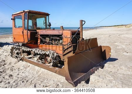 Heavy Bulldozer As Fishing Boat Puller On The Sand At The Seashore