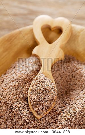 Lovage Seeds, Ajwain Seeds, Carom Seeds in wooden plate with heart shaped spoon