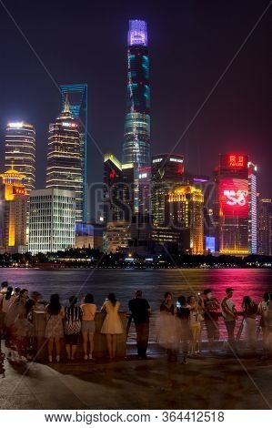 Night View Of Pudong New Area Skyscrapers In Shanghai Across Huangpu River