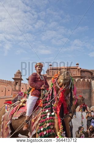 Bikaner, Rajasthan, India - January 11, 2020: Indian Boy Riding On Camel During Camel Festival In Ra