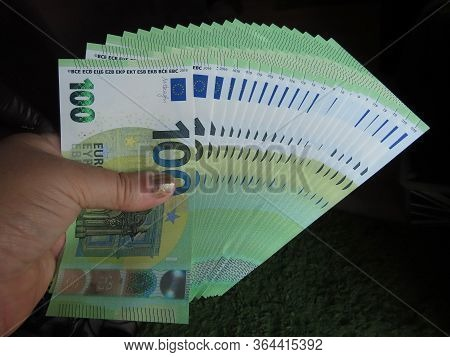 Luxembourg, Luxembourg - September 2, 2019. Hand Holding Euro Banknotes Of 100 Denomination Spread O