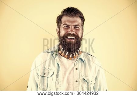 Perfect Male. Brutal Male Put Clothespin With Hearts On Beard. Bearded Man Hipster Casual Style. Lau