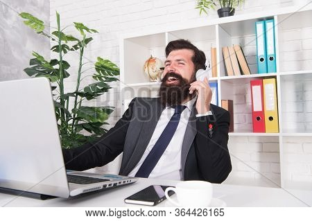 Running Business Online. Retailer Use Laptop And Headphones. Trading Business. Bearded Man Work In B