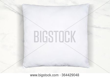 A Soft White Throw Pillow Chilling Atop A Luxurious White Marble Background. Plenty Of Room To Add Y
