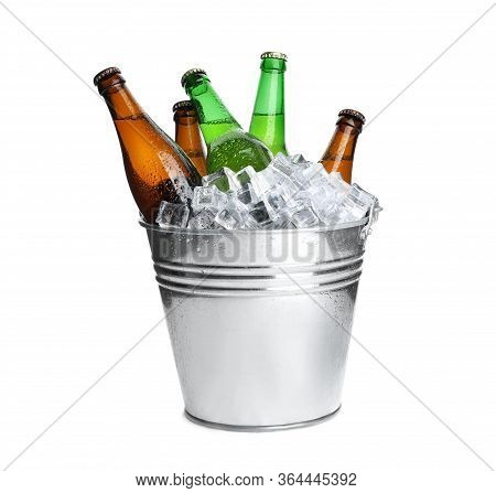 Metal Bucket With Bottles Of Beer And Ice Cubes Isolated On White