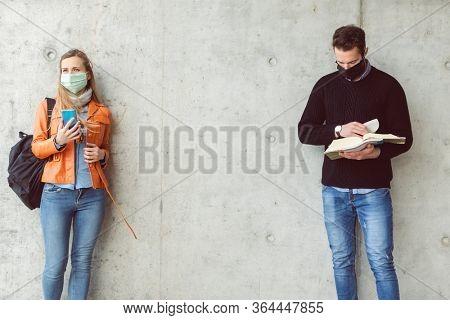 Social distancing on university campus during coronavirus crisis, space between students