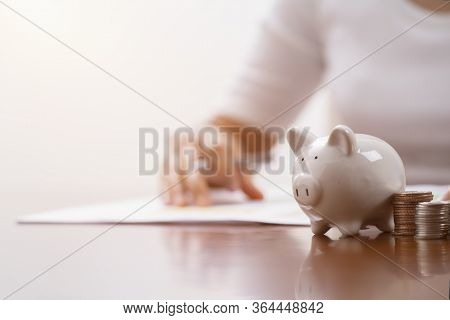 White Piggy Bank And Coins For Saving Money. Concept Saving Money For Finance Accounting