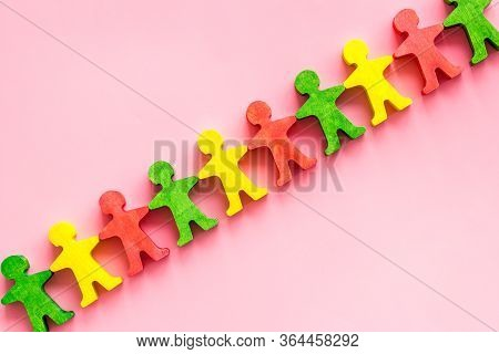 Wooden Figures Of People On Pink Background Top View. Teamwork, Teambuilding Concept