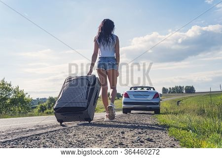 Girl In Sexy Denim Shorts Run Away From Home Without Destination. The Concept Of Road Travel And Hit