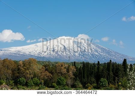 Snow On Mountain Etna, Big Italian Volcano, Seen From The Plain