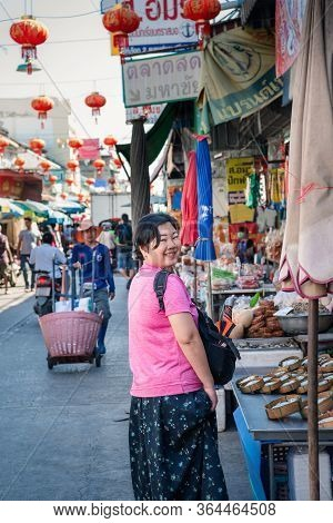 Samut Sakorn, Thailand - February 15, 2020 : Unidentified Asian Woman Shopping At Mahachai Market Is