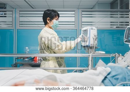 Doctor Medical Care Patient On Bed In Hospital