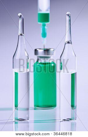 Ampule and syringe macro still life on white