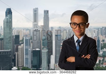 Childhood And People Concept-little African American Boy With Glasses In Business Suit Over City Bac
