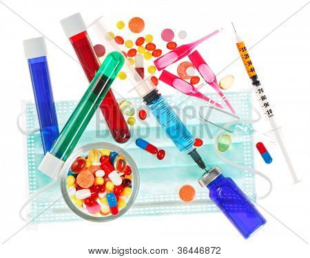 Medical concept with pills, ampoules and syringes isolated on white