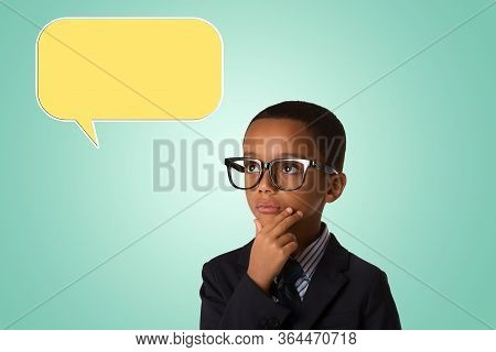 Childhood And People Concept- Pensive Little African American Boy In Business Suit And In Glasses Wi
