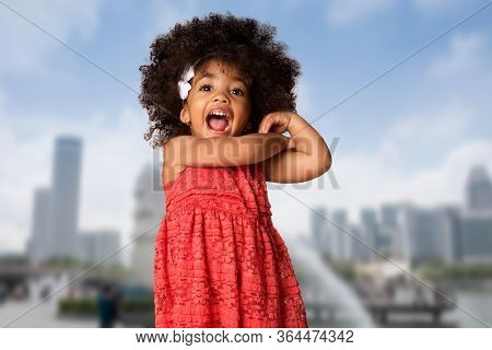 Childhood And People Concept-cheerful Happy African American Little Girl Over Singapore City Backgro
