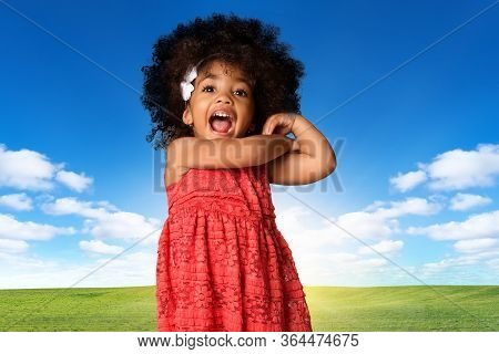 Childhood And People Concept-cheerful Happy African American Little Girl Over Landscape Background