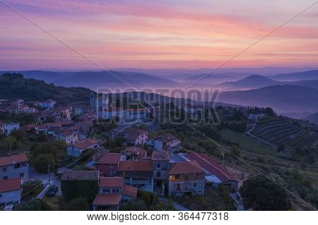 Sunrise In The Mountains. The Golden-pink Sky, Mountains, Morning Fog And A Small Village On The Mou