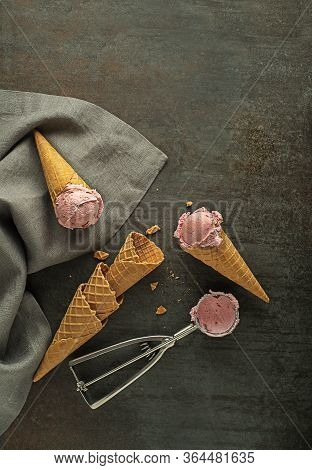 Fruit Ice Cream Scoops, Scooped In To Waffle Cones With A Silver Utensil