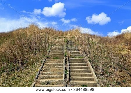 Abandoned Stairs Overgrown, Leading To The Blue Sky With Clouds. Concept Of Stairway To Heaven Or Th