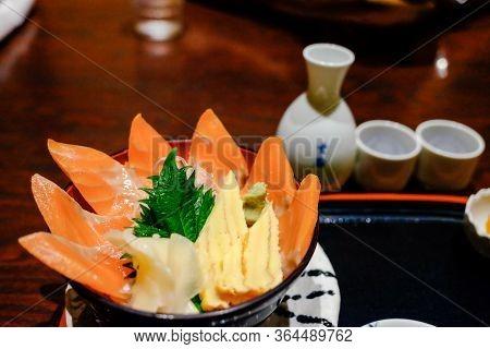 Traditional Japanese Food, Soft Blur Focus Sashimi  Salmon Raw And Sweet Eggs ,seafood Rice Bowl (sa