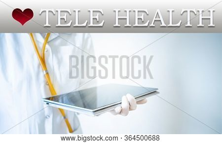 tele health concept doctor with tablet on a laptop screen