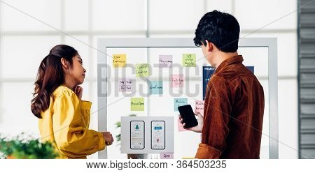 Ux Developer And Ui Designer Presenting  And Testing Mobile App Interface Design On Whiteboard In Me