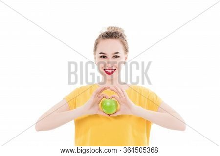 Emotional Portrait Of A Girls Who Eat An Apple On An Isolated White Background. The Concept Of A Hea