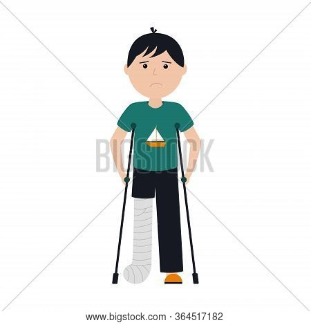 A Sad Boy In A T-shirt And Pants Stands With A Broken Leg On Crutches. The Leg Fracture Was Fixed Wi