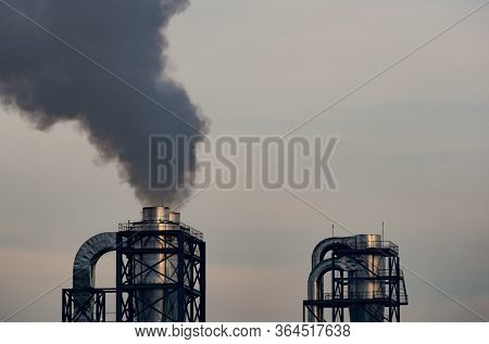 Air Pollution From Factory. Black Smoke From Chimney Of Industrial Pipe. Global Warming Problem Conc