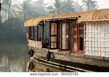 A Traditional House Boat Is Anchored On The Shores Of A Fishing Lake In Kerala Backwaters, India. Th