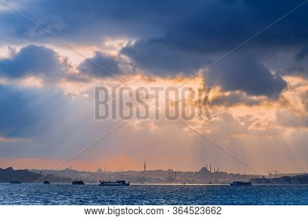 Istanbul At Sunset, Turkey. Beautiful Sunny View Of The Istanbul Waterfront With A Mosque. A Boat Tr