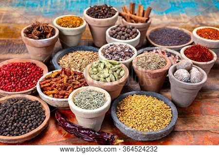 Indian Spices Collection, Dried Colorful Condiment, Nuts, Pods And Seeds And Another Spices In Clay