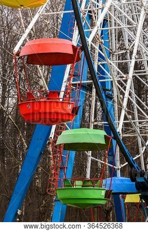 Empty Ferris Wheel Booths In The Park In Early Spring. Ferris Wheel Booths Close-up.