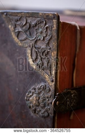 Large Old Leather Book With Metal Corners And Lock. Shallow Depth Of Field.