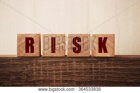 Risk Word On Wooden Blocks. Uncertainty, Unpredictable Situation Crisis And Risks Management Concept
