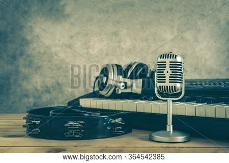 Music Instruments Concept Background. Close Up Group Of Musical Tools The Vintage Michophone, Headph