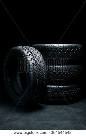 New Tyres Background. Car Tyres Close Up