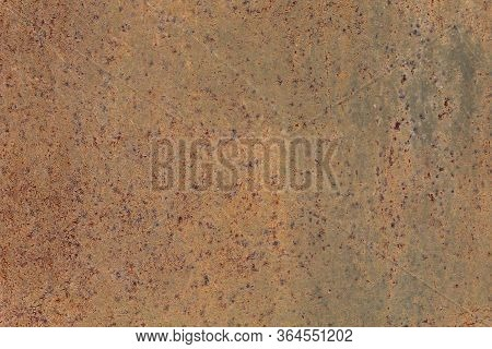 Rusted Metallic Wall Background, Texture. An Old Brown And Rusty Surface With Faded Uneven Color. Ab