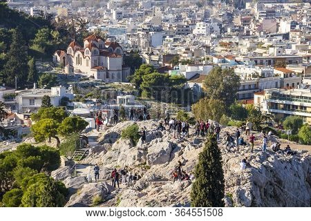 Athens, Greece - December 17, 2019: People Make Photos Of Acropolis And Athens From Areopagus Hill V