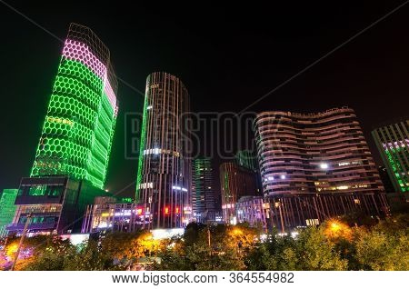 Beijing / China - July 2nd 2016: Night View Of The Futuristic Architecture Of Sanlitun Soho Building