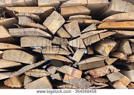 Close Up Background Of A Stack Of Firewood. Woodpile