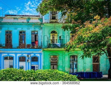 Havana, Cuba, July 2019, View Of Two Colorful Buildings In Calle San Juan De Dios In The Old Part Of