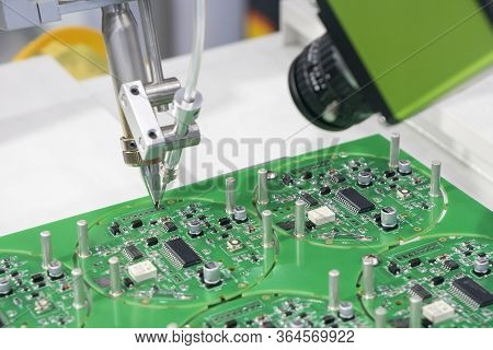The Operation Of Wiring The Motherboard By Robotic Soldering Machine. The Industry 4.0 In Electronic