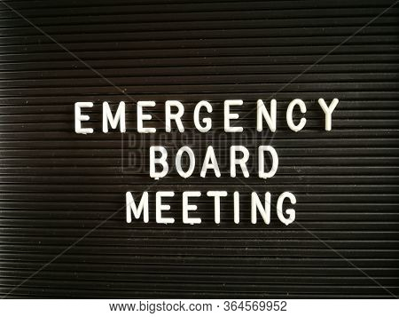 Emergency Board Meeting, written on black letter board